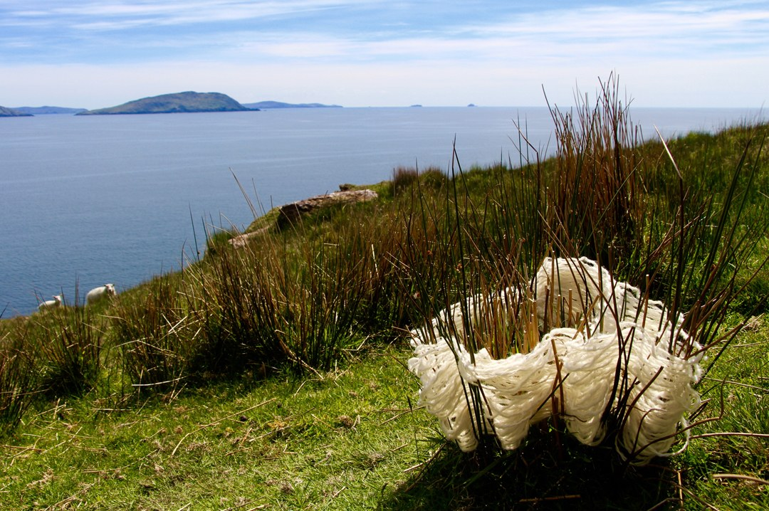 Earth Basket: This wool basket was created with natural wool yarn on living rushes in Ireland. Because wool is found on every fence post and bush, it naturally becomes a part of the color pallet of the landscape. It almost seems like a basket could make itself in the rushes with all the pieces.