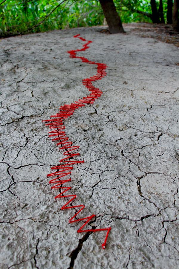 Keep it together- This drought ridden cracked earth was tied together using nails and red string willing it to stay together.