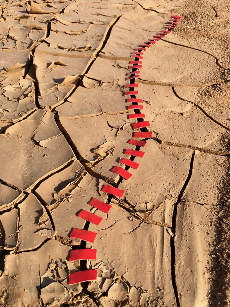 Taped - Cracked earth is taped together willing drought to end and climate change to be fixed. What can you do in your personal life to help our planet?